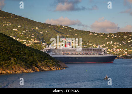 Gigantic Queen Mary II Cruise Ship docked in Charlotte Amalie Harbor, St Thomas, US Virgin Islands - Stock Photo