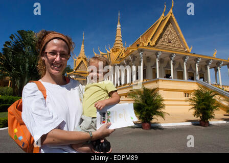 Monk walk outside the Royal Palace. Phnom Penh. Cambodia. Travel with children's. Mother traveling with her daughter. - Stock Photo