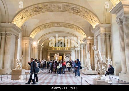Tourists visiting Louvre Museum, Paris, France. - Stock Photo