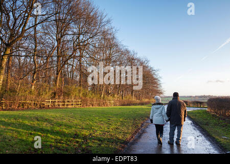 Wentworth Woodhouse, South Yorkshire, UK. 8th January, 2015. UK weather. Warmly dressed mature couple take an afternoon - Stock Photo