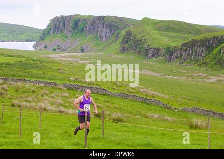 Fell runners in race at The Roman Wall Show, Steel Rigg Hadrian's Wall Path Northumberland England UK - Stock Photo
