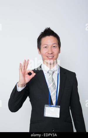 Businessman Showing OK Sign - Stock Photo
