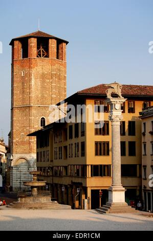 UDINE, ITALY:  The Lion of Venice column (right) in the Piazza della Liberta and the 14th century Campanile of the - Stock Photo