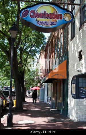 Baltimore, Maryland, Fells Point, street scene with sports bar, Irish Pub, row houses, brick sidewalk - Stock Photo