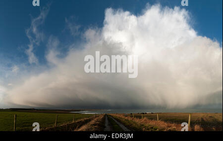 Storm cloud over the Pentland Firth, approaching the north coast of Caithness, near of Mey. Scotland, UK. - Stock Photo