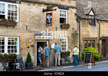 Tourist couples at The Royal Oak inn traditional old gastro pub hotel in Burford in The Cotswolds, Oxfordshire, - Stock Photo