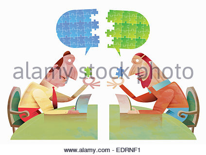 Businessmen communicating using digital tablet to connect jigsaw puzzle speech bubble - Stock Photo