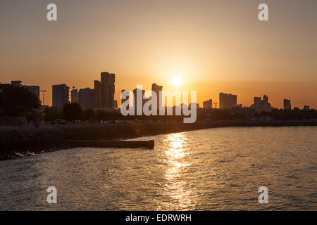 Kuwait City waterfront at sunset. Middle East - Stock Photo