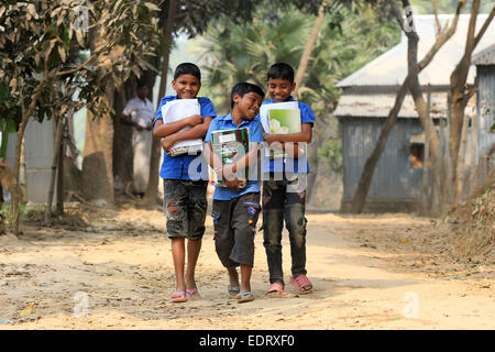 Dhaka 08 January 2015. Three neighboring school-boy on their way to school - Stock Photo