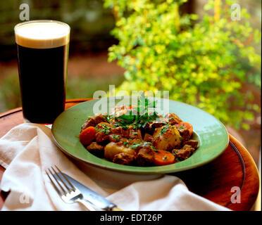 Irish stew and Guinness - Stock Photo