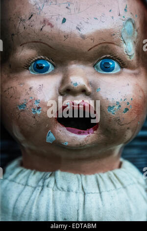 face of an old, vintage doll