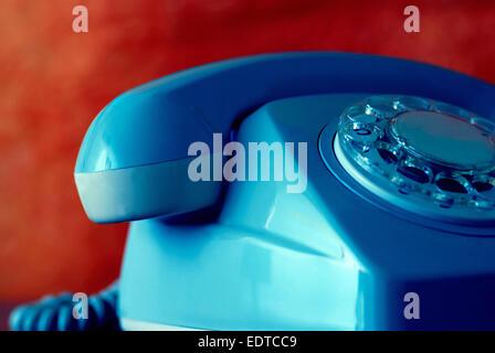 close up detail of a retro blue rotary telephone - Stock Photo