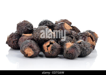 Pile of soapnuts isolated on white background, natural detergent. Drupes contain saponins, soap nuts are used for - Stock Photo