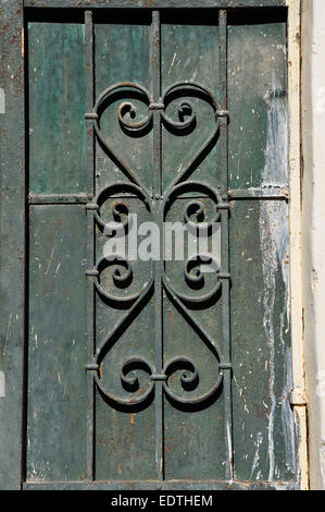 Paint stained rusty iron door background with vintage abstract motif. - Stock Photo