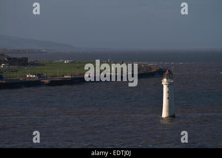 The New Brighton lighthouse, Wirral, as seen from a ship on the river Mersey passing Seaforth Dock. - Stock Photo