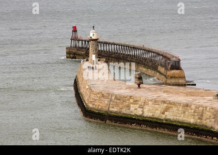 UK, England, Yorkshire, Whitby, East Pier lighthouse and breakwater - Stock Photo
