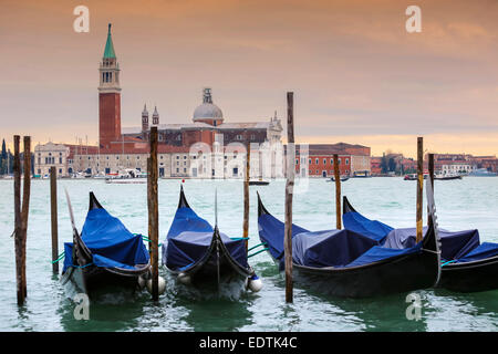 Church of San Giorgio Maggiore on the island of the San Giorgio Maggiore with gondolas parked in the water in Venice, - Stock Photo