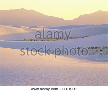 Sunset over gypsum dunes and the San Andres Mountains.  White Sands National Monument, New Mexico Stock Photo