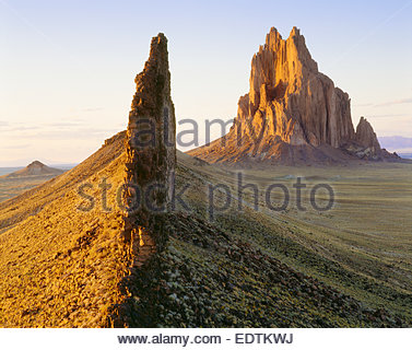 Shiprock, 1100 foot high volcanic monolith, with connected volcanic dike.  Navajo Indian Reservation, New Mexico. - Stock Photo