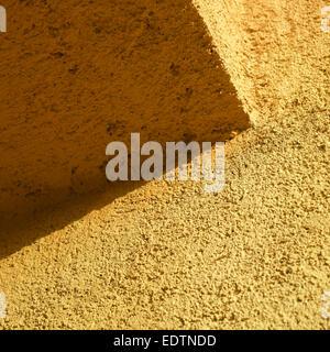orange stucco wall close up - Stock Photo