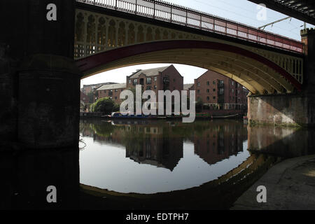 Sunny view, to Castlefield Junction, cast iron arch Manchester South Junction Viaduct crossing Castlefield Basin, - Stock Photo