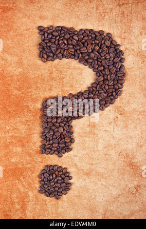 Question Mark made of Roasted Coffee Beans on grunge Background. - Stock Photo