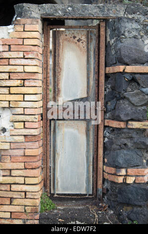 Old door abandoned but locked in Naples (Italy) - Stock Photo