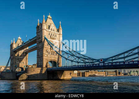 Tower Bridge is a famous landmark, an iconic suspension bridge spanning the River Thames in London - Stock Photo