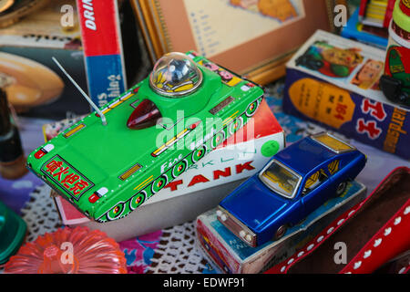 Vintage toy tank and car. - Stock Photo
