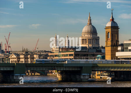 View across the River Thames to cannon Street rail station and St Paul's Cathedral - Stock Photo