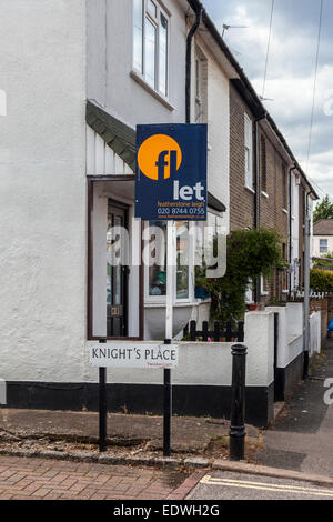 House to let, estate agent's sign outside typical English cottages, Twickenham, Greater London, England - Stock Photo