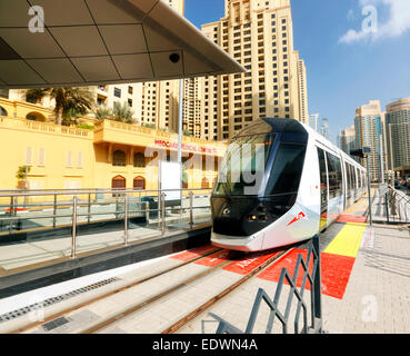 Dubai tram in Dubai Marina -  launch on Nov 14 - Stock Photo