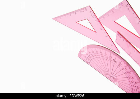 Close up shot of a pink maths set isolated on a white background - Stock Photo