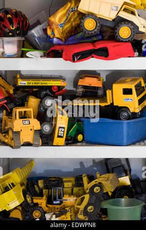 Trucks and diggers for use in the garden. Children's toys. - Stock Photo