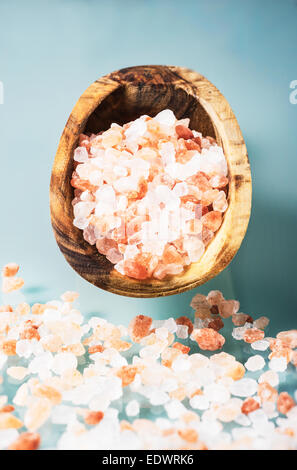 Pink salt from himalaya in a olive wooden spoon - Stock Photo