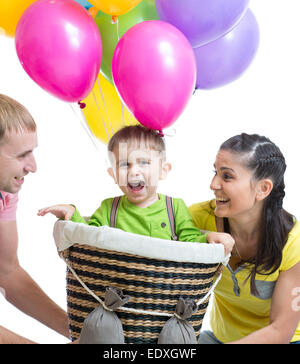 family playing with son in flight on a makeshift balloon - Stock Photo