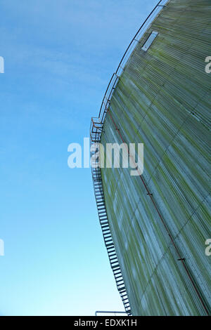 Tainted tanks against blue sky with staircase. Ladder see through. - Stock Photo