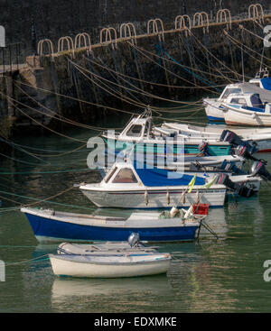 Fishing boats tied up in Tenby Harbour - Stock Photo