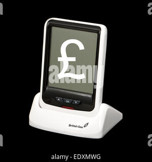 British Gas smart meter (real-time electricity monitor) with £-sign superimposed on screen - Stock Photo