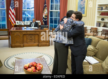 National Security Advisor Susan E. Rice hugs Ricardo Zuniga, National Security Council's Senior Director for Western - Stock Photo