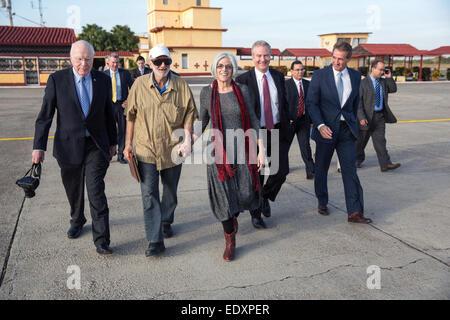 Alan Gross on the tarmac with his wife, Judy Gross, attorney Scott Gilbert,  Sen. Jeff Flake, R-Az., Sen. Patrick - Stock Photo