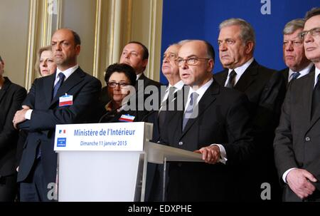 Paris, France. 11th Jan, 2015. French Interior Minister Bernard Cazeneuve (2nd R) speaks after a meeting, during - Stock Photo