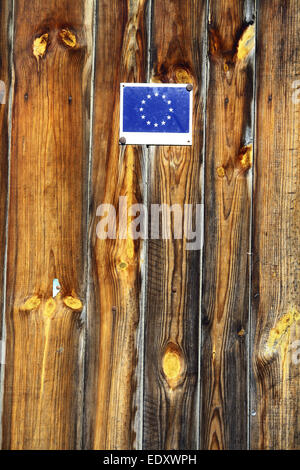 Vertical shot of the European Union flag on some wooden planks. - Stock Photo