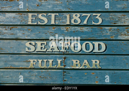 Hand-painted sign on the side of The Marshall Tavern in Marshall California USA - Stock Photo