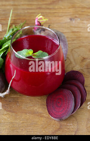 fresh beet juice with mint leaf in a glass - Stock Photo