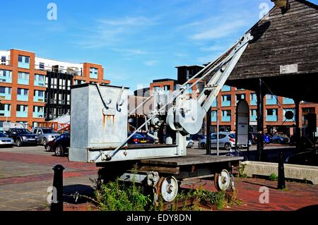 Industrial crane on rails for loading and unloading into boats in Gloucester Docks, Gloucester, Gloucestershire, - Stock Photo