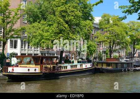 Houseboats on the Prinsengracht canal, Amsterdam, North Holland, Netherlands, Europe - Stock Photo