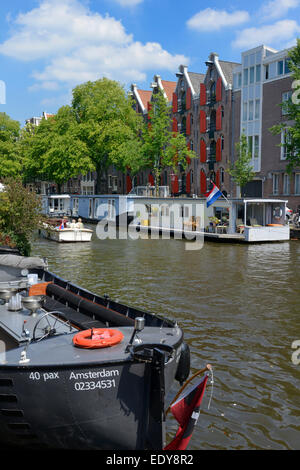 Boats on Prinsengracht canal, Amsterdam, North Holland, Netherlands, Europe - Stock Photo