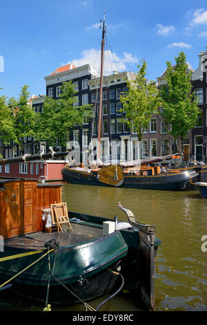 Taditional boats on the Prinsengracht canal, Amsterdam, North Holland, Netherlands, Europe - Stock Photo