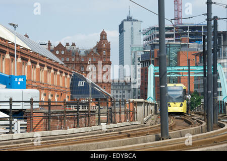 Tram passing the Manchester Central Convention Complex at Deansgate. - Stock Photo